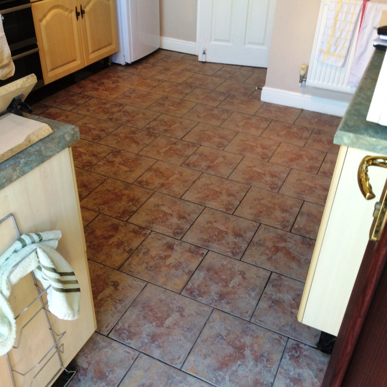 Heavily Soiled Ceramic tiled kitchen floor after cleaning Blaby