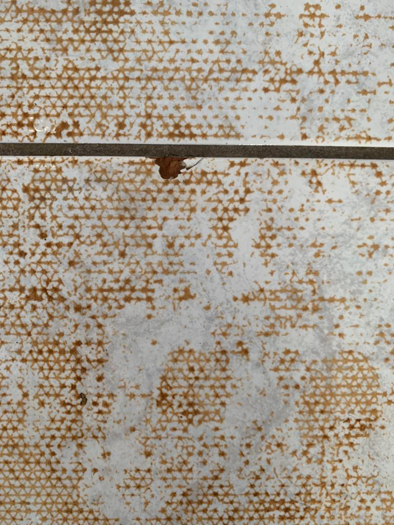 Ceramic Tiles with Carpet Adhesive Contamination Before Cleaning Measham